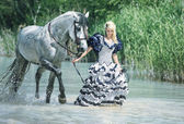 Eleagnt lady walking with the horse — Stock Photo