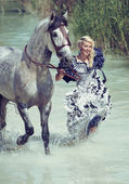 Blonde running with the horse — Stock Photo