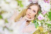 Delicate blonde in the summer garden — Stock Photo