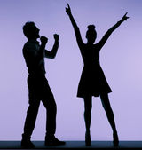 Joyful young couple dancing together — Foto Stock
