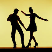 Two silhouettes on the dance-floor — Stock Photo