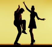 Young fit couple dancing at the party — Stock Photo