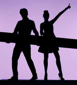 Dancing couple holding the board — Stock Photo