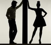 Couple leaning against the thin board — Stock Photo
