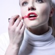Pretty young woman with lipstick — Stock Photo #4964096