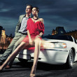 Sexy young couple in front of a limousine — Stock Photo #5691169