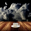 Hot coffee on wooden table with night sky - Stock Photo