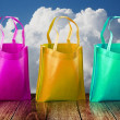 Shopping bag on wooden table with nice sky — Stock Photo