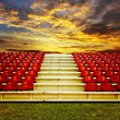 Red bleachers with sunset sky background — Stock Photo