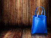 Shopping bag on wooden background — Stock Photo