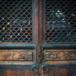 Wooden door in Chinese style — Stock Photo #13774698