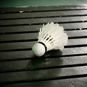 Shuttle cock on wooden table, Badminton sport concept — Stok fotoğraf