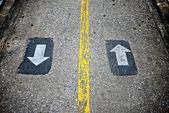 Two way sign on concrete walkway — Stock Photo