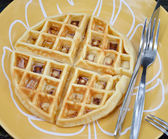 Round waffle with syrup on dish — Stock Photo