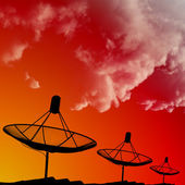 Satellite dishes on rooftop with cloud in morning sky — Stock Photo