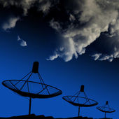 Satellite dishes on rooftop with cloud — Stock Photo