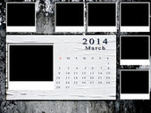 Calendario 2014 prendió con marco de fotos pared grunge — Foto de Stock