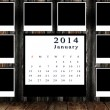 Stock Photo: Calendar 2014 set with photo frame on grunge wall