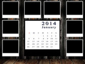 Calendar 2014 set with photo frame on grunge wall — Stock Photo
