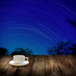 Stock Photo: Drink coffee cup with star trails background