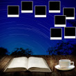 Read astronomy book and photo frame post on wall — Foto Stock #24680573