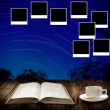 Read astronomy book and photo frame post on wall — Stock Photo