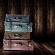 Vintage old leather luggage display in wooden shelf - Stock Photo