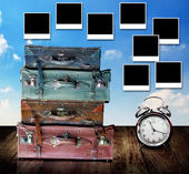 Plan for vacation concept, Travel bag and alarm clock on table with photo frame post on wall — Stock Photo