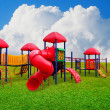 Stock Photo: Colorful children s playground in garden with nice sky background