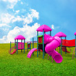 Colorful children s playground in garden with nice sky background — Stock Photo #26017751