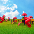 Colorful children s playground in garden with nice sky background — Stock Photo #26017779