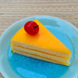 Orange cake in blue dish — Stock Photo