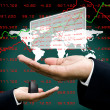 Stock Photo: Analyst datin investor hand with world map background