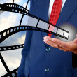 Film strip in businessman hand, Movie industrial  — Stock Photo