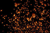 Floating paper lantern in night sky — Stock Photo