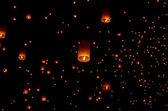 Floating paper lantern in night sky — Stock Photo