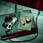 Vintage camera with old photo album, Still life — Stock Photo #35439861