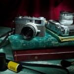 Vintage camera with old photo album, Still life — Stock Photo #35439911