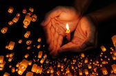 Candle light in hand with Floating lantern, Pray concept — Stock Photo