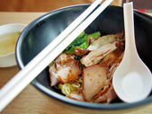 Chinese egg noodles with red pork — Stock Photo