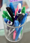 Colorful of pen in clear glass — Stock Photo