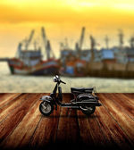 Black scooter parking beside jetty — Foto Stock