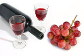 Wine glass and wine bottle with grape isolated on white background  — Stock Photo