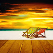 Beach chairs with summer sea and sunset sky — Stock Photo #45118049