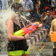 CHIANG MAI, THAILAND - APRIL 15 : People celebrating Songkran or water festival in the streets by throwing water at each other on 15 April 2014 in Chiang Mai, Thailand — Stock Photo #46020365