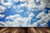 Wooden deck with cloudy sky — Stock fotografie
