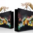 Women hands pick up the christmas shopping bag — Stock Photo #7954470