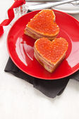 Red caviar on sandwiches — Stock Photo