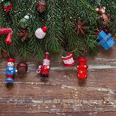 Fronteira de Natal desenha sobre o fundo de madeira — Fotografia Stock