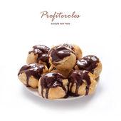 Homemade profiteroles with chocolate cream — Stock Photo